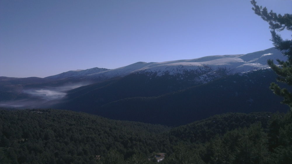 Cloud hangs over the valley in La Sierra de Guadarrama